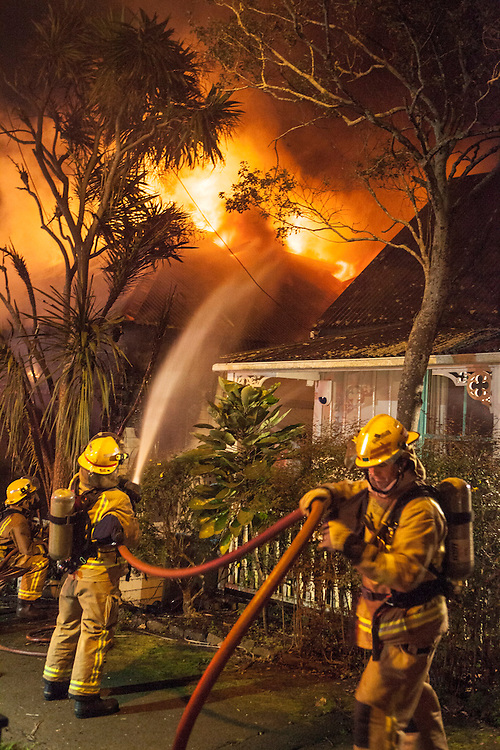 Fire crews battle a fire in a villa on Park Road, Grafton, no injuries were reported, Auckland, New Zealand, Friday, September 13, 2013. Credit:SNPA / Bradley Ambrose