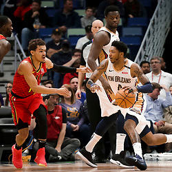 Mar 26, 2019; New Orleans, LA, USA; New Orleans Pelicans guard Elfrid Payton (4) drives past Atlanta Hawks guard Trae Young (11) during the second quarter at the Smoothie King Center. Mandatory Credit: Derick E. Hingle-USA TODAY Sports