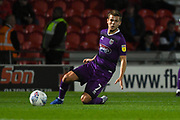 Jake Hessenthaler of Grimsby Town (7) passes the ball forward during the EFL Trophy match between Doncaster Rovers and Grimsby Town FC at the Keepmoat Stadium, Doncaster, England on 9 October 2018.