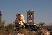 Israel, Jordan River, Near Jericho, Qasr al Yahud. The Greek Orthodox Church on the Jordanian side of the river January 18th 2008. Epiphany, the day of Jesus? baptism, when ?the heavens opened, and he saw the spirit of God descending like a dove and lighting on him.? Celebrated in January by the Greek Orthodox Church. The holy day transforms the area as thousands of pilgrims flock to what is one of the most sacred and least visited places in Israel.