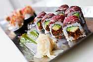 Kobe Beef rolls are the star of this sushi assortment.
