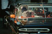 CUBA, HAVANA..Wedding participants in a pre-revolution (1959) vintage Chevrolet Impala..(Photo by Heimo Aga)