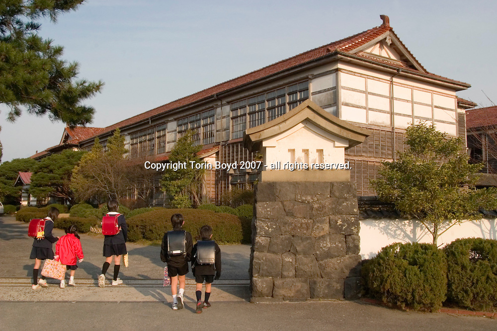 This is the Meirinkan which was originally founded by the feudal lord Yoshimoto Mori of the Choshu Clan in 1719 on the outermost parts of the Hagi Castle. During the 18th and 19th centuries it was considered one of the finest schools in Japan for science and Western knowledge (Rangaku). In 1849 the school moved to it's present site and today functions as an elementary school for the city of Hagi, Yamaguchi Prefecture. It is one of the oldest original school structures in Japan...