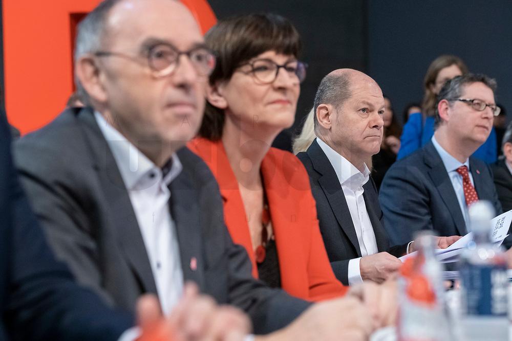 06 DEC 2019, BERLIN/GERMANY:<br /> Norbert Walter-Borjans (R), SPD, Minister a.D., Kandidat fur das Amt des Parteivorsitzenden, Saskia Esken (M), MdB, SPD, Kandidatin fuer das Amt der Parteivorsitzenden, Olaf Scholz (R), SPD, Bundesfinanzminister, SPD Bundesprateitag, CityCube<br /> IMAGE: 20191206-01-007<br /> KEYYWORDS: Party Congress, Parteitag