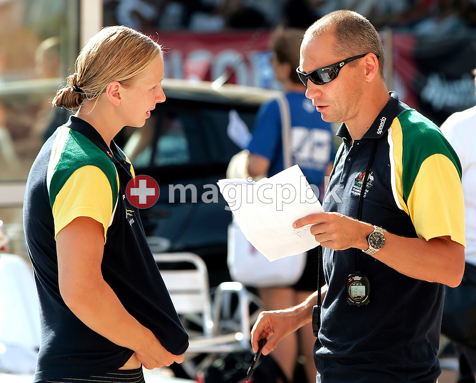 Australia based coach Stephan WIDMER (R) of Switzerland talks to Melanie SCHLANGER (L) of Australia during day two at the 28th International Swimming Meet (50m) held at Piscina Pere Serrat in Barcelona, Spain, Thursday, June 14, 2007. (Photo by Patrick B. Kraemer / MAGICPBK)