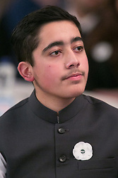 © Licensed to London News Pictures. 15/12/2015. Birmingham, UK. Malala Reception. Pictured, Ahmad Nawaz. One year on from the tragedy of the Taliban attack on the Army Public School (APS) Peshawar, Nobel Prize winner and teenage activist, Malala Yousafzai and her family hosted a special reception to mark the anniversary of one of the deadliest terrorist attacks in Pakistan.The commemorative reception held today was attended by Ahmad Nawaz and Muhammad Ibrahim Khan, two of the young survivors of the tragedy, along with Malala Yousafzai, the peace and education activist, who has made Birmingham her adopted home. As part of the commemorative ceremony, members of the public are being asked to wear a white poppy, representing the global mark of peace. Photo credit : Dave Warren/LNP