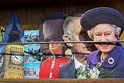 A day after British Prime Minister Boris Johnson successfully asked the Queen to suspend (prorogue) Parliament in order to manoeuvre his Brexit deal with the EU in Brussels, Queen Elizabeth and her son, Prince Charles are being sold as postcards alongside scenes of Windsor Castle, a Grenadier Garudsman and the clockface of Big Ben at the top of Elizabeth Tower, at a tourist kiosk, on 29th August 2019, in Westminster, London, England.