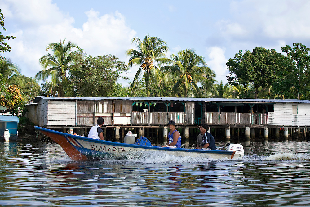 River traffic transports local Costa Ricans around the Tortuguero region.  Located on the Caribbean coast of Costa Rica, Tortuguero is well known for the nesting turtles on its beaches as well as its diverse wildlife along its rivers banks.