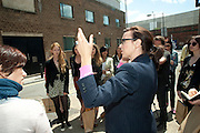 JULIA ROYCE TAKING THE ART TOUR OUTSIDE THE NOBLE/WEBSTER AND WHITEREAD STUDIOS, , Design Your Own Timberland breakfast and Autumn/ Winter 2011 preview. Timberland. 1 Fournier St. London. Followed by an art tour by Julia Royce. 8 June 2011. <br /> <br />  , -DO NOT ARCHIVE-© Copyright Photograph by Dafydd Jones. 248 Clapham Rd. London SW9 0PZ. Tel 0207 820 0771. www.dafjones.com.