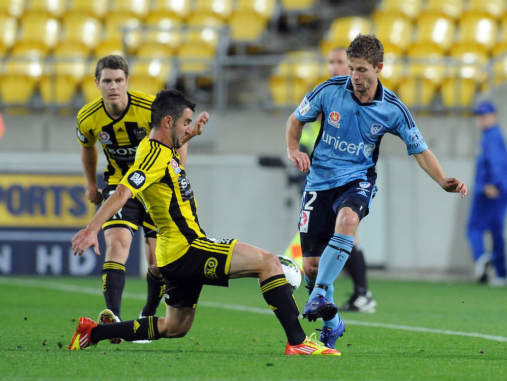 Phoenix's Daniel Sanchez, left' contests the ball with Sydney FC's Sebastian Ryall in the A-League football match, Westpac Stadium, Wellington, New Zealand, Friday, March 30, 2012. Credit:SNPA / Ross Setford