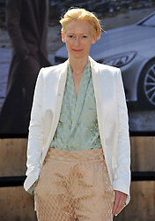 Image ©Licensed to i-Images Picture Agency. 10/07/2014. Berlin, Germany . Tilda Swinton attends the Roshi Porkar show during the Mercedes-Benz Fashion Week Spring/Summer 2015 at Erika Hess Eisstadion. Picture by  Schneider-Press / i-Images<br /> UK & USA ONLY