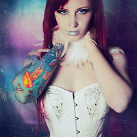 A sinister young woman with bright red hair in a leather corset with tattoos on her arms