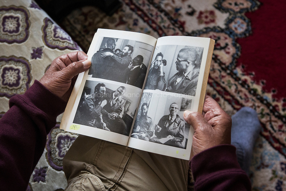 CASABLANCA, MOROCCO - 14 MAY 2016: Luqman Abdul-Hakeem (82), a close follower of Malcolm X that chauffeured the African American activist around and introduced him to Cuban leader  Fidel Castro in September 1960, shows pictures of the meeting of the two leaders published in Rosemari Mealy's book &quot;Fidel &amp; Malcolm X. Memories of a meeting&quot;, in his home in Sidi Maarouf, a district of Casablanca, Morocco, on May 14th 2016.<br /> <br /> Born in Cleveland, OH, in 1934, Luqman Abdul-Hakeem was raised in Flushing, Queens, and then moved to Bayside, where he graduated in 1952. He attended the New York Technical University for a few months before enrolling in the Navy, where he stayed for two years. Though he had asked for ship duty, he ended up in Springfield, Mass., and Glennclose, Ill. He moved to Brooklyn when his hitch was done and by 1966 was studying jujitsu and aikido. He met Malcolm X during one of his sermons on 116th street in Harlem, New York, in the late 50&rsquo;s. In 1985, Mr. Hakeem decided to move to Marocco because America wasn't a country where he wanted to raise hois children. He has been teaching aikido in the two dojos he owns in Casablanca until 2014, when he underwent a surgery.