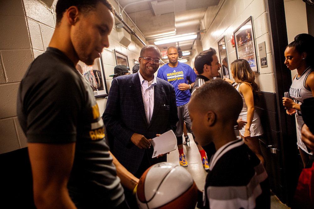 BROOKLYN, NY - MARCH 2, 2015:   Brooklyn District Attorney Kenneth P. Thompson waits behind the scenes at Barclay's Center so that his son Kenny can get an autograph from Golden State Warriors point guard Stephen Curry while the two attend a game between the Brooklyn Nets and the Golden State Warriors at the Barclay's Center.