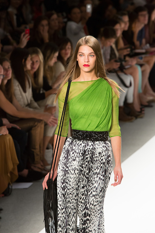 Black and white jungle print trousers with a bright green top. By Carlos Miele at the Spring 2013 Mercedes-Benz Fashion Week in New York.