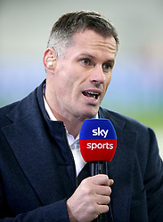Sky Sports Pundit Jamie Carragher commentates on the match prior to the beginning of the Premier League match at London Stadium.