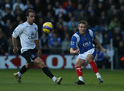PORTSMOUTH, ENGLAND - SATURDAY, DECEMBER 9th, 2006: Matthew Taylor of Portsmouth clashes with Andy Van der Meyde of Everton during the Premiership match at Fratton Park. (Pic by Chris Ratcliffe/Propaganda)