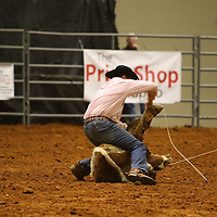 Libby Ezell | BUY AT PHOTOS.DJOURNAL.COM<br /> after roping the calf in the Calf Roping event the competitors had to hog tie the calf