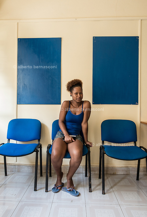 Cabo Verde, Boa Vista, young woman waiting in a office