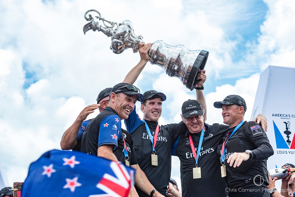 The Great Sound, Bermuda, 26th June 2017. Emirates Team New Zealand COO Kevin Shoebrdge, CEO Grant Dalton, Helmsman Peter Burling, Principal Matteo de Nora and skipper Glenn Asby hold aloft the America's Cup.
