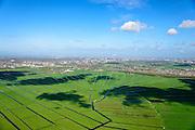 Nederland, Noord-Holland, Gemeente Ouder-Amstel, 09-04-2014; Amstelland, Polder de Rondehoep (ook Polder de Ronde Hoep), een van de grootste onbebouwde weidegebieden van de Randstad met karakteristiek stervormig kavelpatroon. Dit slotenpatroon van gerende verkaveling is ontstaan ten tijde van de ontginning in de middeleeuwen. Aan de horizon Ouderkerk, Amsterdam Zuid-as.<br /> The Polder Rondehoep (or Polder Round Hoep), one of the largest undeveloped pasture area's in the Randstad with characteristic star-shaped pattern. This pattern is the result of the extraction during the Middle Ages. Skyline Amsterdam at the horizon.<br /> luchtfoto (toeslag op standard tarieven);<br /> aerial photo (additional fee required);<br /> copyright foto/photo Siebe Swar