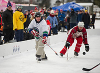 Derek Bekar of the Stonedam Islanders takes a shot during semi final action with the Wrap Solutions team during Sunday's New England Pond Hockey Classic.  (Karen Bobotas/for the Laconia Daily Sun)