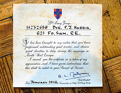 ***COPY FOUND HERE: https://www.dropbox.com/s/bj4js2ci6ctmtyw/Soldiers.txt *** © Licensed to London News Pictures. 05/02/2014 London, UK. Driver Fred Harris' certificate commending outstanding service after saving a Lieutenant in 1944 who would go on to be a General twice knighted by the Queen. Photo credit : Simon Jacobs/LNP