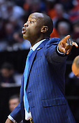 SAN DIEGO, CA - MARCH 16:  Charleston Cougars head coach Earl Grant calls a play for his team during a first round game of the Men's NCAA Basketball Tournament against the Auburn Tigers at Viejas Arena in San Diego, California. Auburn won 62-58.  (Photo by Sam Wasson)