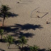 Locals play beach volleyball on Ipanema beach,  Rio de Janeiro,  Brazil. 29th July 2010. Photo Tim Clayton..