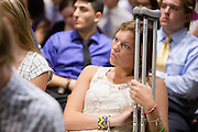 Delaney Gbur listens during the Ohio University College of Business Freshman Convocation at Nelson Commons on Aug. 23, 2014. Photo by Lauren Pond