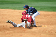 Alabama's Austen Smith (18) is tagged out by Ole Miss' Blake Newalu (6) at Oxford-University Stadium in Oxford, Miss. on Sunday, March 20, 2011.