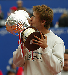 MONTE-CARLO, MONACO - Sunday, April 20, 2003: Juan Carlos Ferrero (Spain) kisses the Tennis Masters Monte-Carlo trophy after beating Guillermo Coria (Argentina) 6-2, 6-2 in the final of the Tennis Masters Monte-Carlo. (Pic by David Rawcliffe/Propaganda)