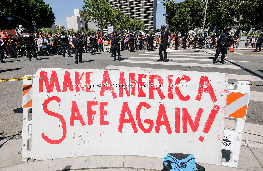 A group of President Donald Trump supporters in foreground and May Day protesters taunt each other as they are separated by police officers during the annual May Day March in Los Angeles, May 1, 2017. (Photo by Ringo Chiu/PHOTOFORMULA.com)<br /> <br /> Usage Notes: This content is intended for editorial use only. For other uses, additional clearances may be required.