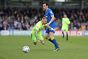 AFC Wimbledon defender Sean Kelly (22) and Peterborough United striker Marcus Maddison (11) during the EFL Sky Bet League 1 match between AFC Wimbledon and Peterborough United at the Cherry Red Records Stadium, Kingston, England on 17 April 2017. Photo by Stuart Butcher.