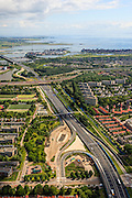 Nederland, Noord-Holland, Amsterdam, 14-06-2012; Watergraafsmeer met werkzaamheden in het kader van de weguitbreiding van de A10-Oost. Rechts van de Ring A10 Diemen. Zicht op  IJburg..View on the residential district Watergraafsmeer in the east of Amsterdam, direction new urban development IJburg and ringroad A10..luchtfoto (toeslag), aerial photo (additional fee required).foto/photo Siebe Swart