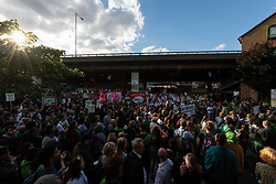 © Licensed to London News Pictures. 14/06/2018. London, UK. Relatives and members of the public take part in a silent march to commemorate the 1st Anniversary of the Grenfell Tower fire disaster. Photo credit: Ray Tang/LNP