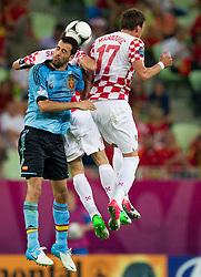 Sergio Busquets of Spain vs Darijo Srna of Croatia and Mario Mandzukic of Croatia during the UEFA EURO 2012 group C match between  Croatia and Spain at PGE Arena Gdansk on June 18, 2012 in Gdansk / Danzig, Poland. (Photo by Vid Ponikvar / Sportida.com)