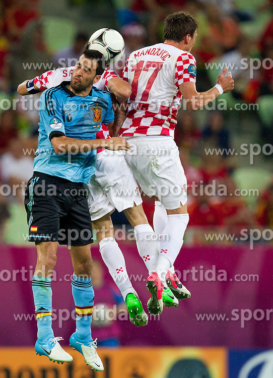 Sergio Busquets of Spain vs Darijo Srna of Croatia and Mario Mandzukic of Croatia during the UEFA EURO 2012 group C match between  Croatia and Spain at PGE Arena Gdansk on June 18, 2012 in Gdansk / Danzig, Poland. (Photo by Vid Ponikvar / Sportida.com)