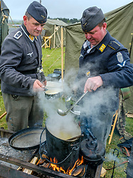 Sunday 7th May 2017 East Fortune:  Wartime Experience at the National Museum of Flight, East Fortune.  Reenactors from WW2 German Forces Living History Association prepare food in a field kitchen.<br /> <br /> (c) Andrew Wilson | Edinburgh Elite media