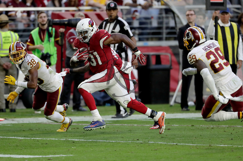 Arizona Cardinals running back David Johnson (31) runs for a touchdown as Washington Redskins cornerback Kendall Fuller (38) and safety Duke Ihenacho (29) defend during the second half of an NFL football game, Sunday, Dec. 4, 2016, in Glendale, Ariz. (AP Photo/Rick Scuteri)