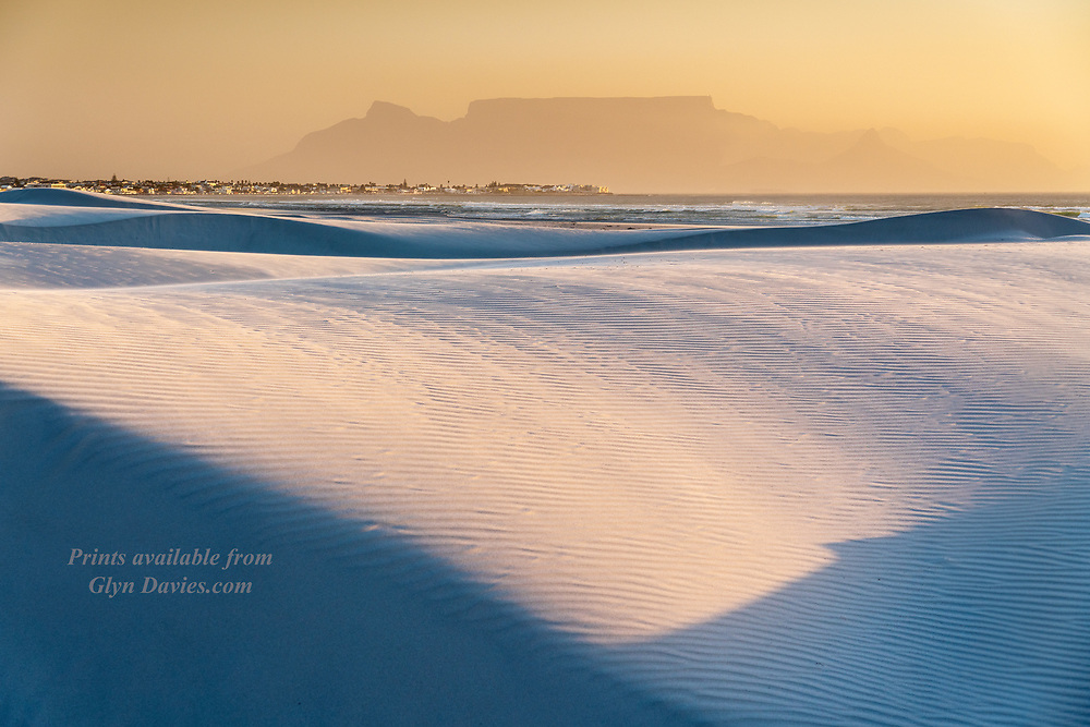 So happy to be back here in South Africa. One of the first things we did was head down to the stunning white sand dunes from where the distinctive looking Table Mountain can be seen looming in the background haze. So many truly fantastic landscapes in Africa.