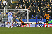 Wolverhampton Willy Boly (15) blocks   Reading Sone Aluko (14) attempt on goal during the EFL Sky Bet Championship match between Reading and Wolverhampton Wanderers at the Madejski Stadium, Reading, England on 18 November 2017. Photo by Gary Learmonth.