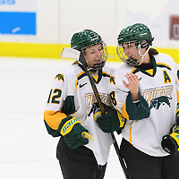 1st year forward Chelsea Hallson (12) of the Regina Cougars and 5th year forward Kylie Gavelin (13) of the Regina Cougars in action during the Women's Hockey Home Game on October 15 at Co-operators arena. Credit: Arthur Ward/Arthur Images