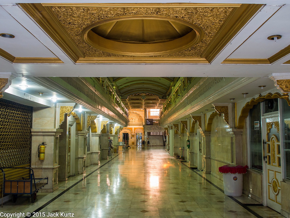 "08 FEBRUARY 2015  BANGKOK, THAILAND: The north entrance to Gurdwara Siri Guru Singh Sabha in Bangkok. Thailand has a small but influential Sikh community. Sikhs started coming to Thailand, then Siam, in the 1890s. There are now several thousand Thai-Indian Sikh families. Gurdwara Siri Guru Singh Sabha was established in 1913. Construction of the current building, adjacent to the original Gurdwara (""Gateway to the Guru""), started in 1979 and was finished in 1981. The Sikh community serves a daily free vegetarian meal at the Gurdwara that is available to people of any faith and background.    PHOTO BY JACK KURTZ"
