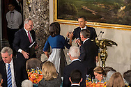 President Barack Obama touches glasses with First Lady Michelle Obama at the Inaugural Luncheon in Statuary Hall at the U.S. Capitol on Monday, January 21, 2013 in Washington, DC.