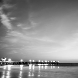 San Clemente pier at night black and white picture. San Clemente is a popular coastal beach city in Orange County Southern California in the United States of America. Copyright ⓒ 2017 Paul Velgos with all rights reserved.