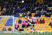 Mansfield Town forward Mani Dieseruvwe wins the ball in the air during the Sky Bet League 2 match between Mansfield Town and Northampton Town at the One Call Stadium, Mansfield, England on 28 March 2016. Photo by Jon Hobley.
