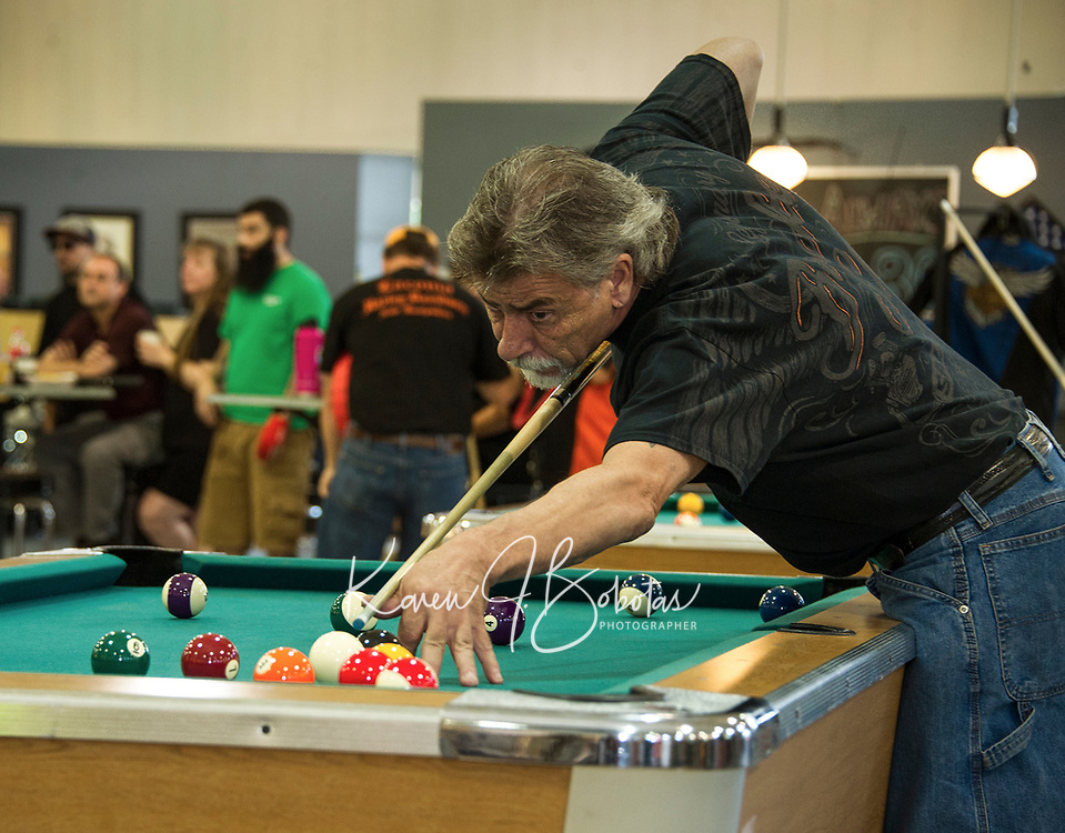 Dan Dube lines up his shot during the Harley Davidson Pool Tournament with Tavern Players on Sunday afternoon to benefit the Childrens Auction.  (Karen Bobotas/for the Laconia Daily Sun)