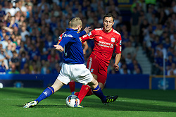 LIVERPOOL, ENGLAND - Saturday, October 1, 2011: Liverpool's Stewart Downing in action against Everton's Tony Hibbert during the Premiership match at Goodison Park. (Pic by David Rawcliffe/Propaganda)