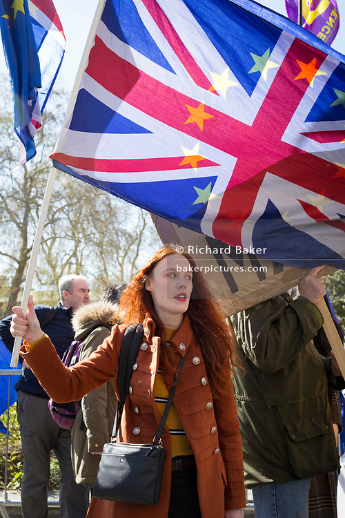On the day that Prime Minister Theresa May returns to Brussels to negotiate an expected Brexit delay, young pro-EU remainers protest outside parliament in Westminster, in London, England.